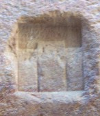 The image, above right, includes 3 block gods, side by side. Perhaps these represented a Nabataean trinity. The image on the left is above an inscription.