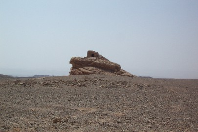 The location of this Jordanian Nabataean tomb is remarkably reminiscent to some of the Nabataean tombs found in Meda'in Saleh in Saudi Arabia. It is a single tomb carved out of a free standing rock in the open desert.