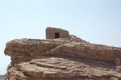 Much of the top of the rock is worn off, but it is still possible to see the outline of pillars and other decorations.