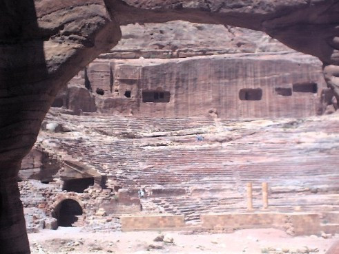 Petra's theater is cut out of solid rock, and badly deteriorated. The front of the theater, including most of the stage was badly damaged by floods. The photograph on the left was taken from inside a rock cave across the road from the theater.